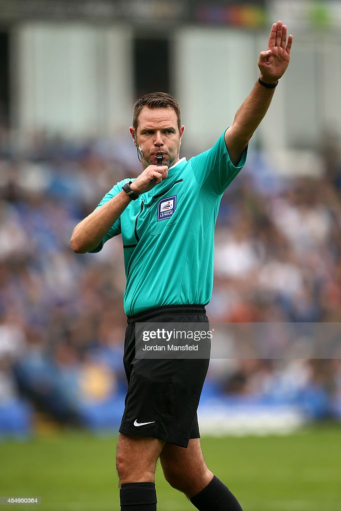 Referee James Linington makes a call during the Sky Bet League One match between Peterborough United and Port Vale at London Road Stadium on September 6, 2014 in Peterborough, England.