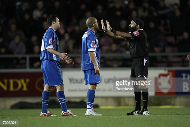 Referee Jarnail Singh gestures to Adam Chambers and Adam Boyd of Leyton Orient during the Coca Cola League One Match between Northampton Town and...