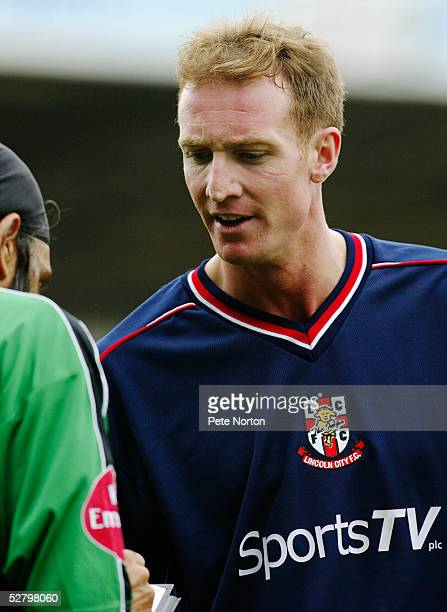 Referee Jarnail Singh talks to Peter Gain of Lincoln City during the Coca Cola League Two match between Northampton Town and Lincoln City held at...