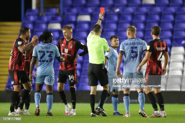 Referee Jarred Gillett gives a straight red to Gustavo Hamer of Coventry City after he slaps Steve Cook of Bournemouth during the Sky Bet...