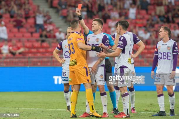 Referee Jarred Gillett issues Liam Reddy of Perth Glory a red card after his tackle on Wanderers Jaushau Sotirio during the round 23 ALeague match...