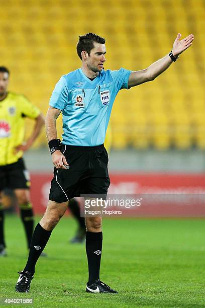 Referee Jarred Gillett makes a call during the round three ALeague match between the Wellington Phoenix and the Brisbane Roar at Westpac Stadium on...