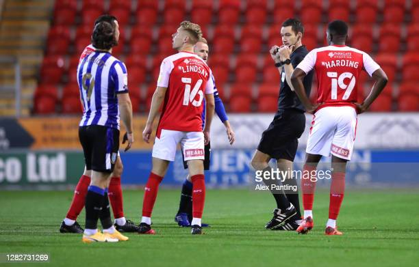 Referee Jarred Gillett orders the players off the pitch due to a drone flying above the stadium during the Sky Bet Championship match between...