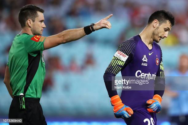 Referee Jarred Gillett sends Vedran Janjetovic of the Wanderers from the field after a straight red card for a hand ball during the round eight...