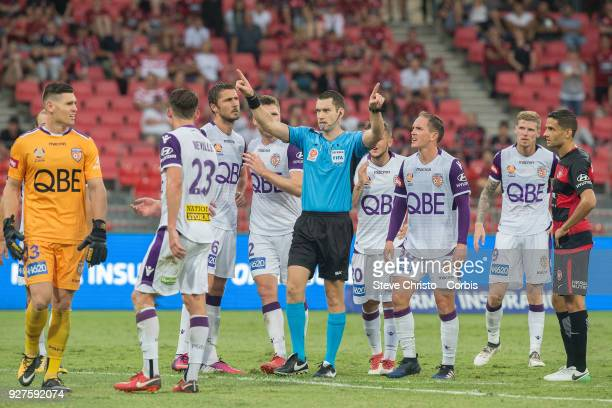 Referee Jarred Gillett signals for the video referee after Liam Reddy's tackle on Wanderers Jaushau Sotiro during the round 23 ALeague match between...