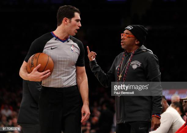 Referee Jason Goldenberg exchanges words with film director producer and Knicks fan Spike Lee during an NBA basketball game between the Atlanta Hawks...
