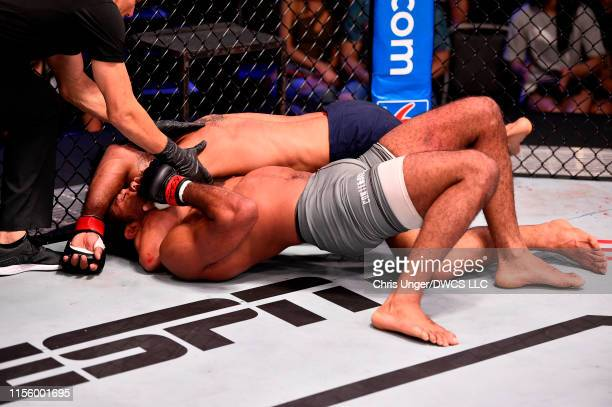 Referee Jason Herzog stops Antonio Arroyo of Brazil as he submits Stephen Regman in their middleweight bout during Dana White's Contender Series at...