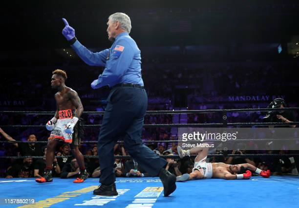 Referee Jay Nady sends Jermell Charlo to a neutral corner after Charlo knocks down Jorge Cota during the third round of their super welterweight...