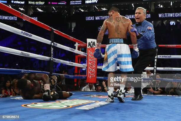 Referee Jay Nady steps in to pull Lucas Matthysse away after he knocked down Emmanuel Taylor during their welterweight bout at TMobile Arena on May 6...