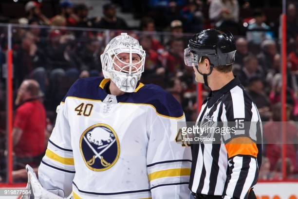 referee Jean Hebert chats with Robin Lehner of the Buffalo Sabres during a break in the game against the Ottawa Senators at Canadian Tire Centre on...