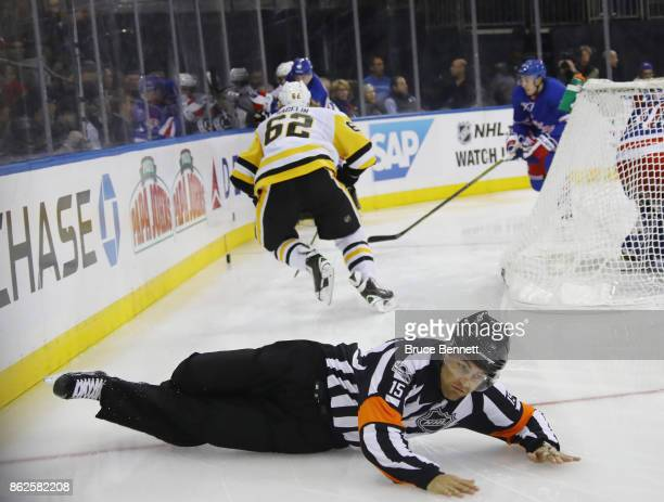 Referee Jean Hebert hits the ice during the game between the New York Rangers and the Pittsburgh Penguins at Madison Square Garden on October 17 2017...