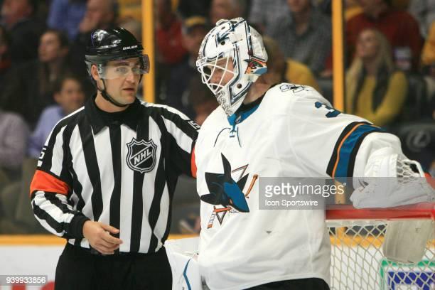 Referee Jean Hebert talks with San Jose Sharks goalie Martin Jones during the NHL game between the Nashville Predators and San Jose Sharks held on...