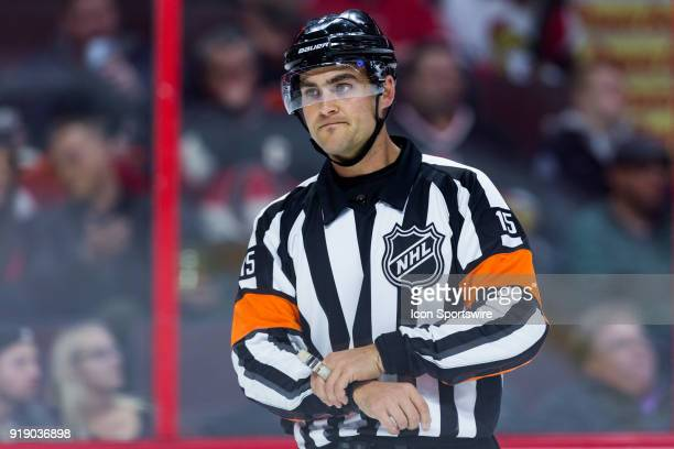 Referee Jean Hebert waits as there is a TV timeout during first period National Hockey League action between the Buffalo Sabres and Ottawa Senators...