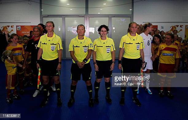 Referee Jenny Palmqvist of Sweden and assistants Helen Karo Anna Nystrom and Jacqui Melksham prepare to lead Mexico and New Zealand onto the field...