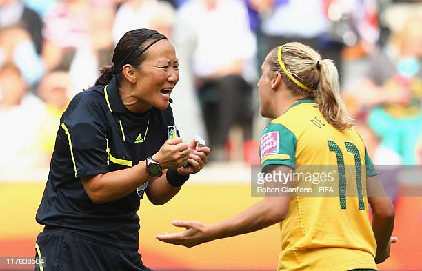 Referee Jenny Palmqvist of Sweden has words with Lisa De Vanna of Australia during the FIFA Women's World Cup 2011 Group D match between Brazil and...