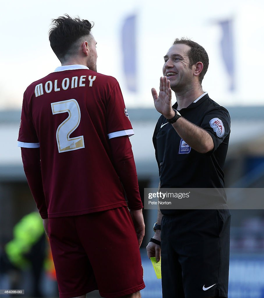 Referee Jeremy Simpson makes a point to Brendon Moloney of Northampton Town during the Sky Bet League Two match between Northampton Town and York City at Sixfields Stadium on February 21, 2015 in Northampton, England.