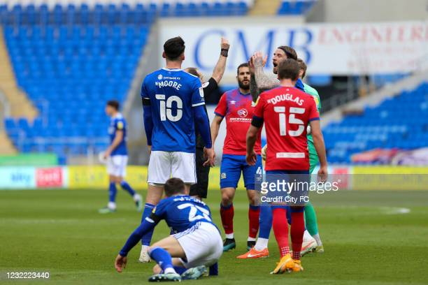 Referee Jeremy Simpson shows Thomas Kaminski of Blackburn Rovers a Yellow Card during the Sky Bet Championship match between Cardiff City and...
