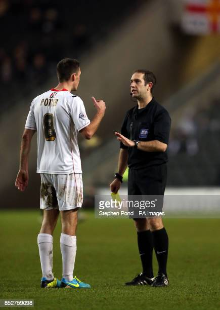 Referee Jeremy Simpson speaks to Milton Keynes Dons' Darren Potter before booking him