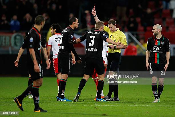 Referee Jeroen Sanders shows a red card to Ryan Koolwijk of NEC during the Dutch Eredivisie match between FC Utrecht and NEC Nijmegen held at Stadion...