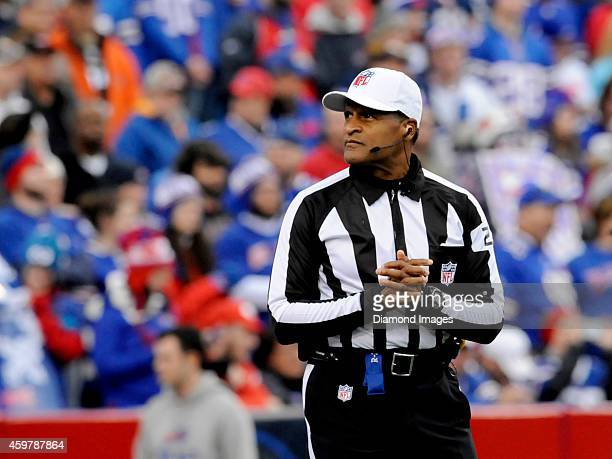 Referee Jerome Bogar watches the video board before the opening kickoff of a game between the Cleveland Browns and the Buffalo Bills on November 30...