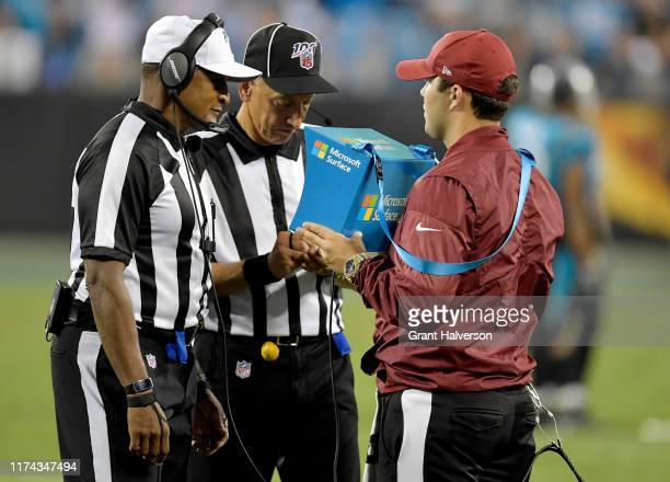 Referee Jerome Boger and back judge Tony Steratore review a call during the fourth quarter of the game between the Carolina Panthers and the Tampa...