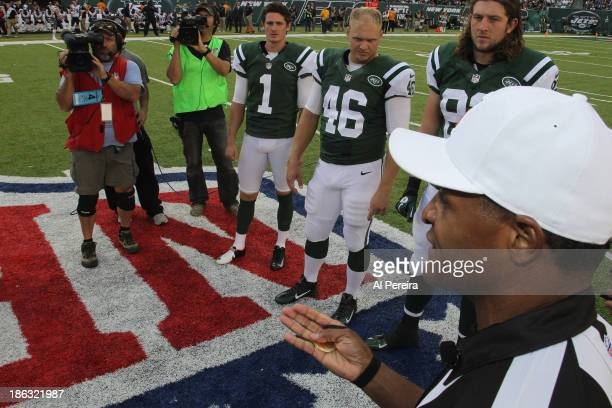 Referee Jerome Boger calls the coin toss before Overtime in the game between the New York Jets and the New England Patriots at MetLife Stadium on...
