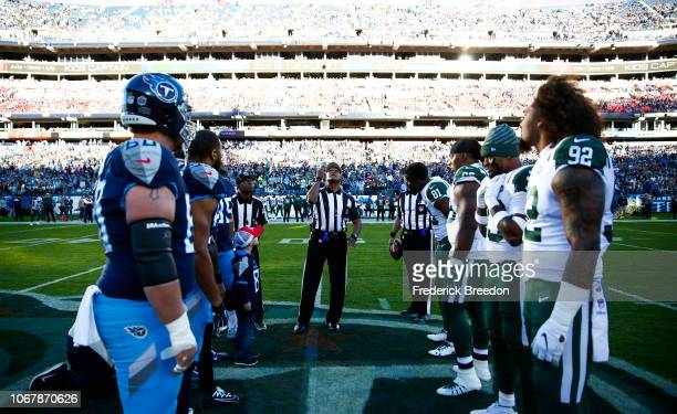 Referee Jerome Boger carries out the coin toss before the Tennessee Titans play the New York Jets at Nissan Stadium on December 2, 2018 in Nashville,...