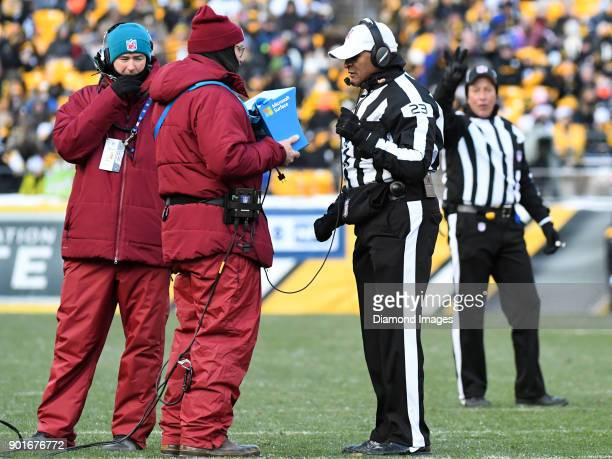 Referee Jerome Boger reviews a play in the second quarter of a game on December 31 2017 between the Cleveland Browns and Pittsburgh Steelers at Heinz...
