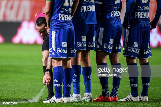 Referee Jerome Brisard sprays a temporary line during the Ligue 1 match between Troyes and Bordeaux on January 13 2018 in Troyes France