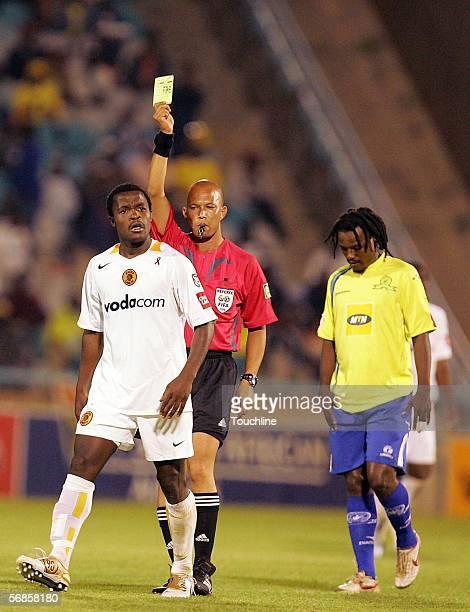 Referee Jerome Damon gives Tinashe Nengomasha a yellow card to Jabulani Mendu during a PSL match between Kaizer Chiefs and Mamelodi Sundowns at...