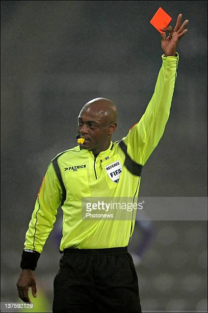 Referee Jerome Efong Nzolo shows a red card during the Cofidis Cup match between Beerschot AC and KV Kortrijk on January 18 2012 in Antwerpen Belgium