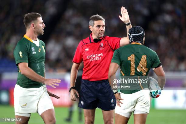 Referee Jerome Garces gestures during the Rugby World Cup 2019 Group B game between New Zealand and South Africa at International Stadium Yokohama on...