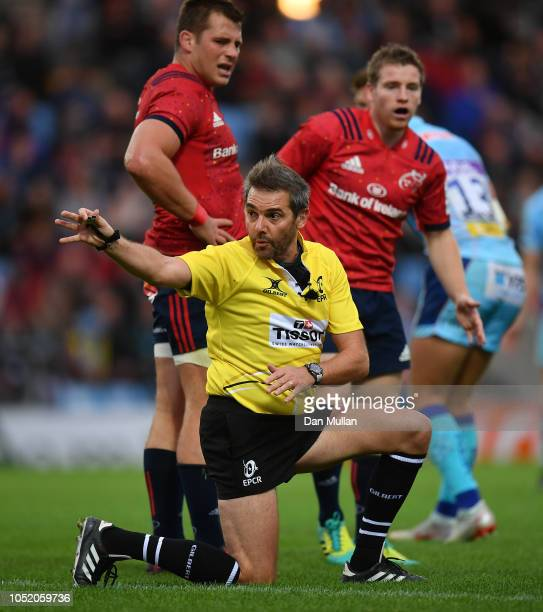 Referee Jerome Garces signals a knock on during the Heineken Champions Cup match between Exeter Chiefs and Munster Rugby at Sandy Park on October 13...