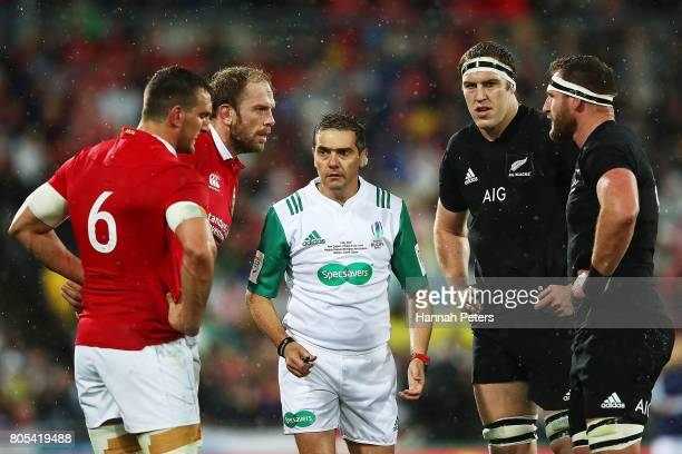 Referee Jerome Garces talks to Alun Wyn Jones and Sam Warburton of the Lions and Brodie Retallick and Kieran Read of the All Blacks during the...