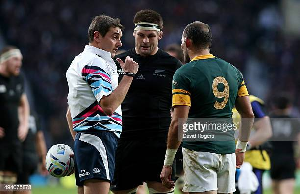 Referee Jerome Garces talks to Captains Richie McCaw of the New Zealand All Blacks and Fourie Du Preez of South Africa during the 2015 Rugby World...