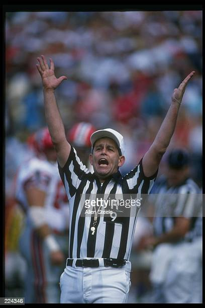 Referee Jerry Markbreit signals a touchdown during a game between the Dallas Cowboys and the Atlanta Falcons at Texas Stadium in Dallas Texas The...