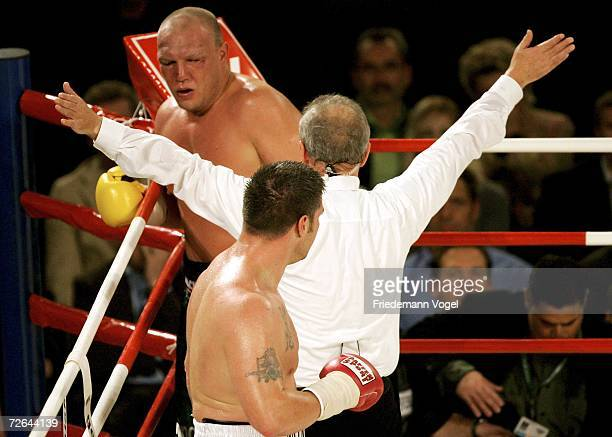Referee Joachim Jacobsen signals the finish of the Heavyweight fight between Axel Schulz of Germany and Brian Minto of USA at the Gerry Weber Stadium...