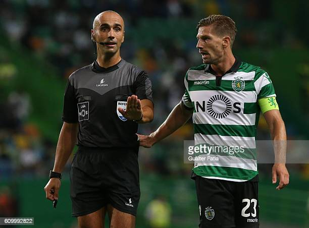 Referee Joao Capela with Sporting CP's midfielder Adrien Silva in action during the Primeira Liga match between Sporting CP and Estoril Praia at...
