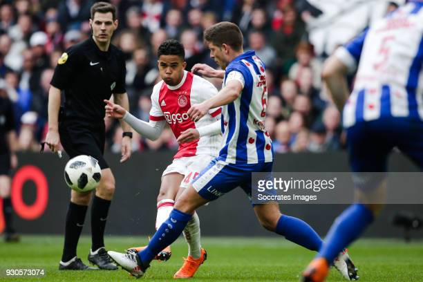 referee Jochem Kamphuis Justin Kluivert of Ajax Stijn Schaars of SC Heerenveen during the Dutch Eredivisie match between Ajax v SC Heerenveen at the...