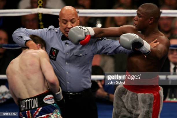 Referee Joe Cortez seperates Floyd Mayweather Jr and Ricky Hatton of England during their WBC world welterweight championship fight at the MGM Grand...