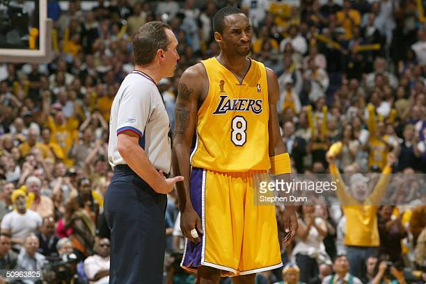 Referee Joe DeRosa talks to Kobe Bryant of the Los Angeles Lakes in Game two of 2004 NBA Finals at Staples Center on June 8, 2004 in Los Angeles,...