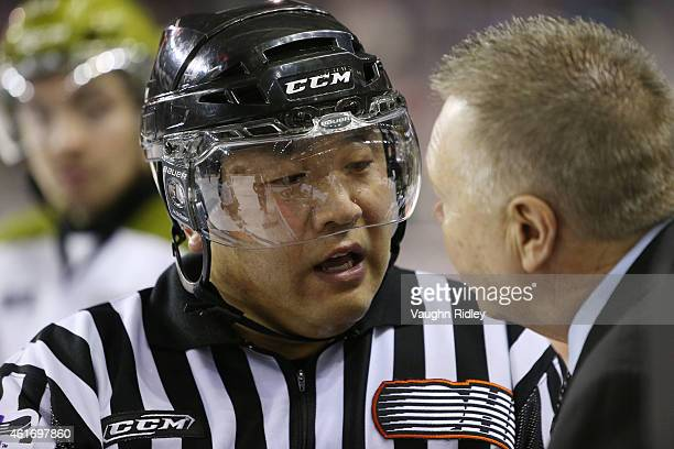 Referee Joe Park has words with North Bay Battalion Head Coach Stan Butler during an OHL game against the Niagara IceDogs at the Meridian Centre on...