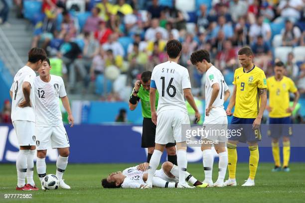 Referee Joel Aguilar checks if Koo JaCheol of Korea Republic is ok as he goes down injured during the 2018 FIFA World Cup Russia group F match...