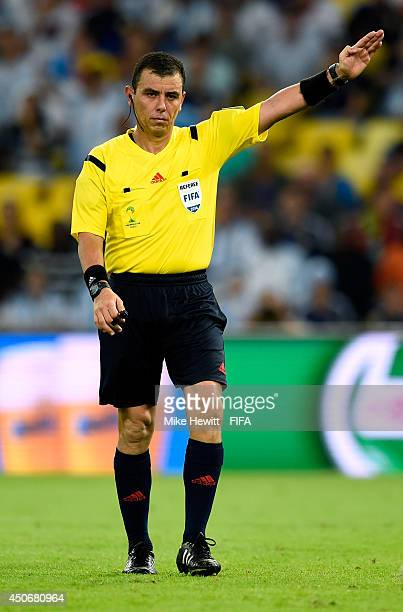 Referee Joel Aguilar gestures during the 2014 FIFA World Cup Brazil Group F match between Argentina and BosniaHerzegovina at Maracana on June 15 2014...