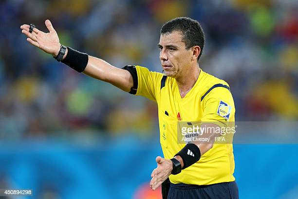 Referee Joel Aguilar gestures during the 2014 FIFA World Cup Brazil Group C match between Japan and Greece at Estadio das Dunas on June 19 2014 in...