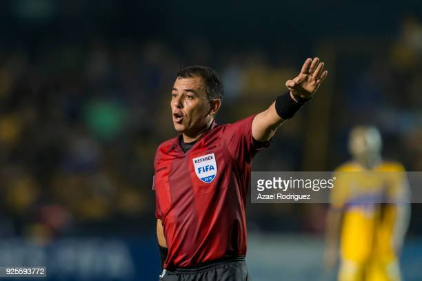 Referee Joel Aguilar gestures during the second leg match between Tigres UANL and Herediano as part of round of 16 of the CONCACAF Champions League...