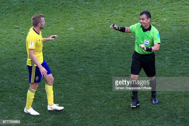 Referee Joel Aguilar has words with Sebastian Larsson of Sweden during the 2018 FIFA World Cup Russia group F match between Sweden and Korea Republic...