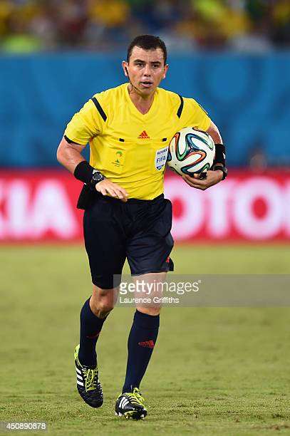 Referee Joel Aguilar holds the ball during the 2014 FIFA World Cup Brazil Group C match between Japan and Greece at Estadio das Dunas on June 19 2014...