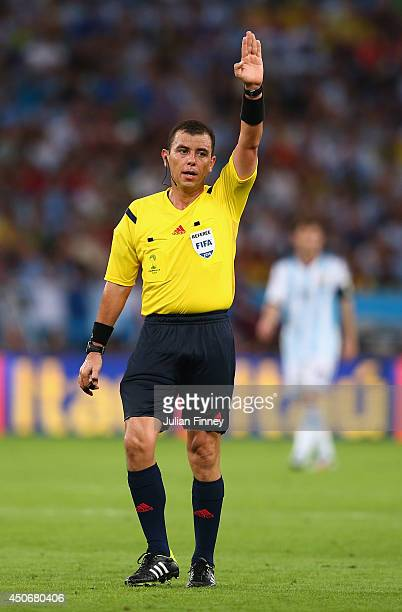 Referee Joel Aguilar in action during the 2014 FIFA World Cup Brazil Group F match between Argentina and BosniaHerzegovina at Maracana on June 15...