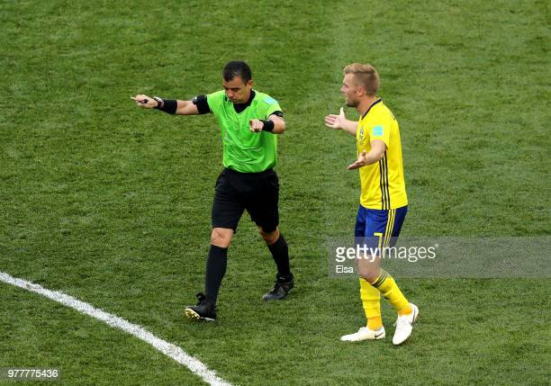 Referee Joel Aguilar indicates a VAR desicion before awarding Sweden a penalty during the 2018 FIFA World Cup Russia group F match between Sweden and...